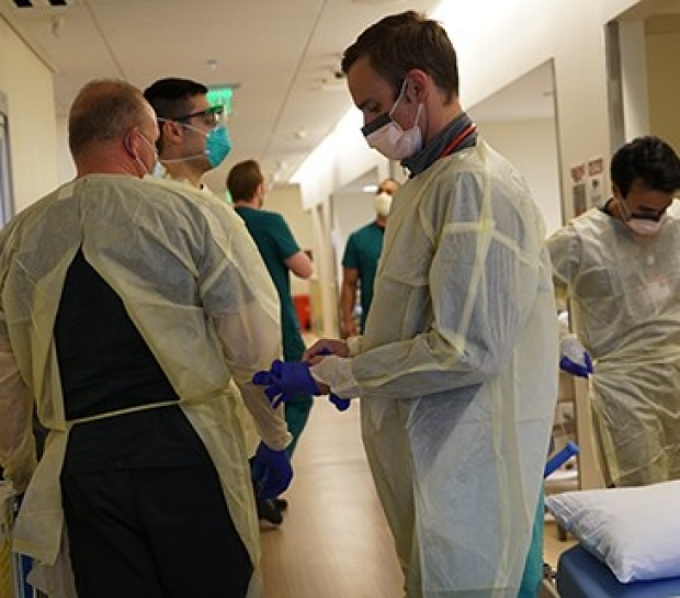 Stanford Emergency Medicine faculty don PPE during the COVID-19 pandemic